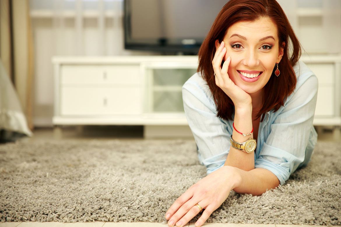 happy woman on clean carpet